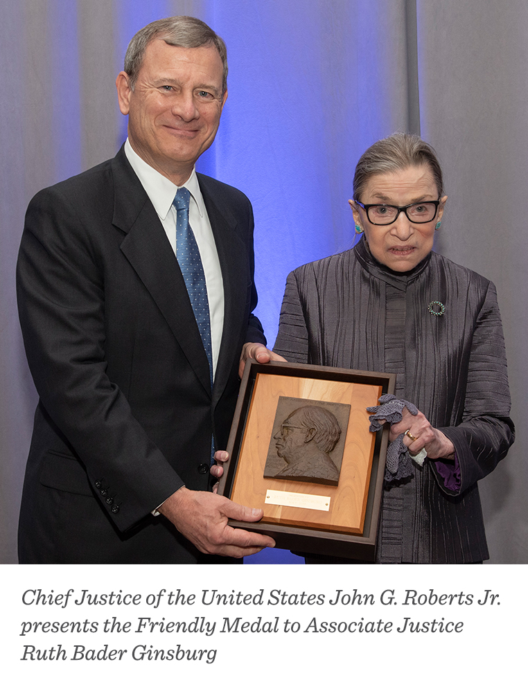 Chief Justice of the United States John G. Roberts Jr. presents the Friendly Medal to Associate Justice Ruth Bader Ginsberg.